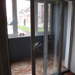 Раздвижная ПВХ-дверь на лоджии - вид из комнаты